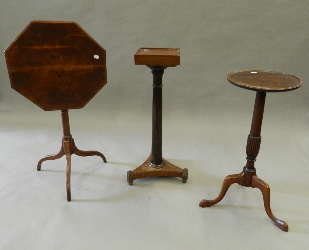 Three mahogany tripod tables. The largest 46.5 cm wide.