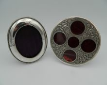 An Indian silver circular hand tooled foliate design picture frame with five apertures (tests as