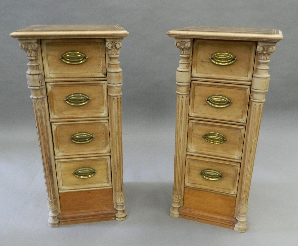 Lot 911 - A pair of small banks of pine drawers with leather tops. 80.5 cm high.