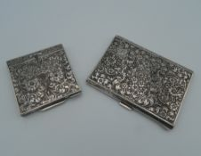 An 800 Continental silver compact of square form, heavily chased with flowers and scroll work,