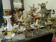 Four various cut glass chandeliers. The largest 55 cm high.