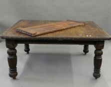 A Victorian carved oak single leaf extending dining table. 190 cm extended.