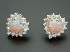 A pair of silver and opal earrings