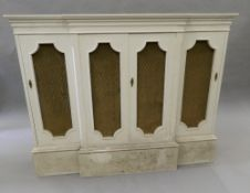 A modern white painted break front side cabinet. 127.5 cm wide.