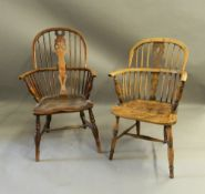 Two 19th century elm seated Windsor chairs. The largest 59 cm wide.