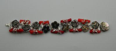 A coral mounted silver bracelet. 19 cm long.