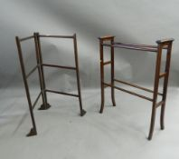 An Edwardian mahogany towel rail and another. The former 67 cm long.