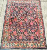 A Persian wool rug with floral ground. 187 x 135 cm.
