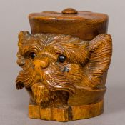 A late 19th century Black Forest carved wooden inkwell Formed as a dog,