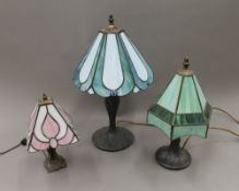 Three Tiffany style table lamps. The largest 46 cm high.