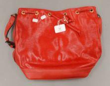A red Louis Vuitton handbag. 36 cm wide.
