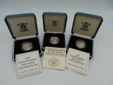 Three silver £1 coins