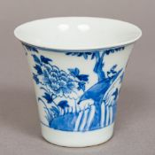 An 18th/19th century Chinese blue and white porcelain cup Of flared cylindrical form,