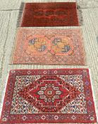 A Persian wood rug together with two others. The former 131 x 79 cm.