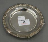 A small silver dish. 13 cm diameter (2.