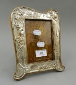 An Art Nouveau silver photograph frame. 21.5 cm high.
