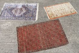 A silk rug and two another Persian rugs