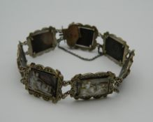 A Continental 800 silver mounted cameo bracelet depicting various classical scenes.