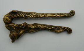A set of nutcrackers, formed as a nude lady. 12.5 cm long.