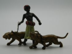 A cold painted bronze model of an Arab and tigers. 7.5 cm high.