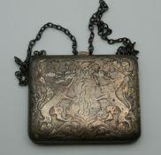 A silver purse. 9 cm wide.