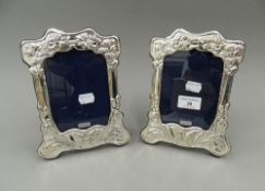 A pair of Art Nouveau style silver photograph frames. 20.5 cm high.
