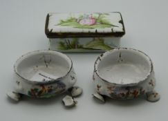 A pair of late 18th/early 19th century enamel decorated salts and an enamel decorated box.