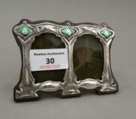 A sterling silver Art Nouveau style double photograph frame. 11 cm wide.