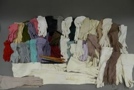 A collection of ladies vintage gloves, including long evening kid leather gloves, sheer gloves,