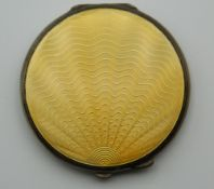 An enamel decorated silver compact