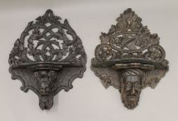 Two 19th century oak carved wall brackets. Each approximately 42 cm high.