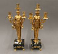 A pair of gilt figural candlesticks. 44.5 cm high.