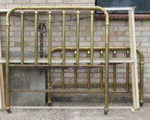 An early 20th century American brass framed double bed