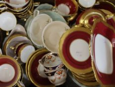 A quantity of Aynsley gilt decorated tea wares and a quantity of Johnson Brothers dinner wares.