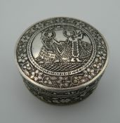 An Eastern silver box. 5.75 cm diameter (45.6 grammes).