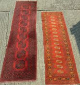 A red ground Persian wood runner and another. 254 x 80 cm and 321 x 85 cm.