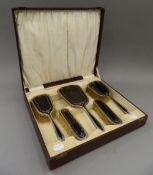 A cased silver and tortoiseshell dressing set (lacking comb). The case 34 cm wide.