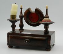 A 19th century rosewood pocket watch holder/desk stand. 17 cm wide.