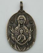 A Russian icon pendant. 5 cm high.