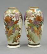 A pair of late 19th century Satsuma vases. Each 15.5 cm high.