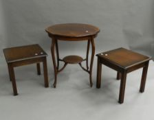 An Edwardian mahogany side table and two modern coffee tables.