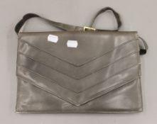 A Mario Valentino grey handbag. 31 cm wide.