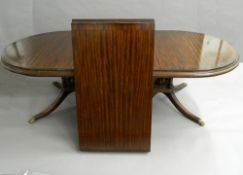 A reproduction twin pillar dining table. 309.5 cm long.