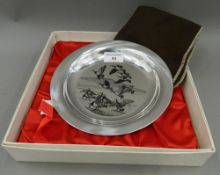 A silver dish decorated with geese by PETER SCOTT, boxed. 20 cm diameter (6 troy ounces).