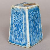 A Chinese blue and white porcelain ink block Decorated in the round with scrolling foliage inside