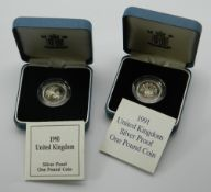 Two solid silver £1 coins,