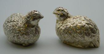 A pair of silver plate cruets formed as partridges. Each 6 cm long.