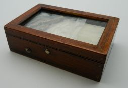 A small Victorian rosewood cased music box. 11.5 cm long.