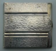 A white metal card case, marked Alpacca. 5.25 cm wide. 39.9 grammes.