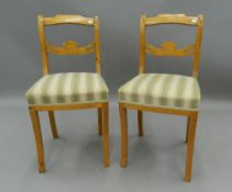 A pair of late 19th century Biedermeier style chairs. 39 cm wide. The property of Germaine Greer.